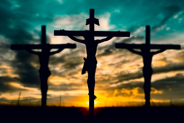 47687912 - silhouette of jesus with cross over sunset concept for religion, worship, prayer and praise.