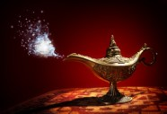 48355407 - magic lamp from the story of aladdin with genie appearing in blue smoke concept for wishing, luck and magic