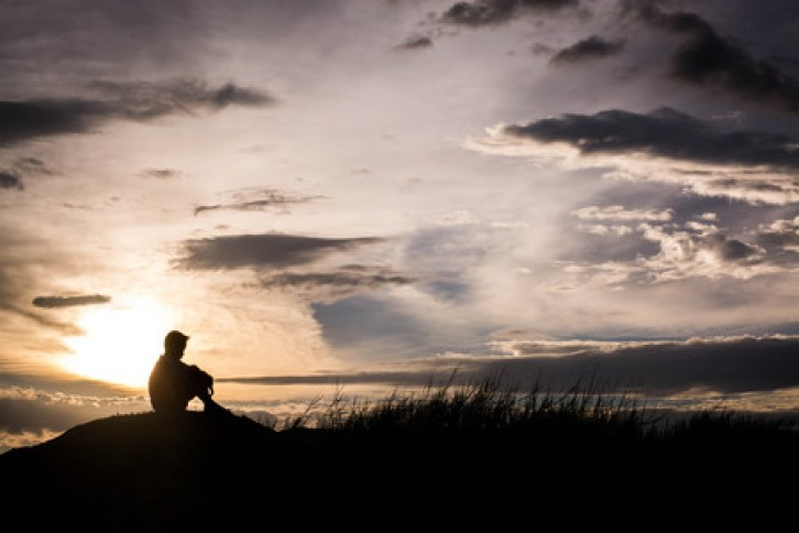 57330243 - sad boy silhouette worried on the meadow at sunset ,silhouette concept