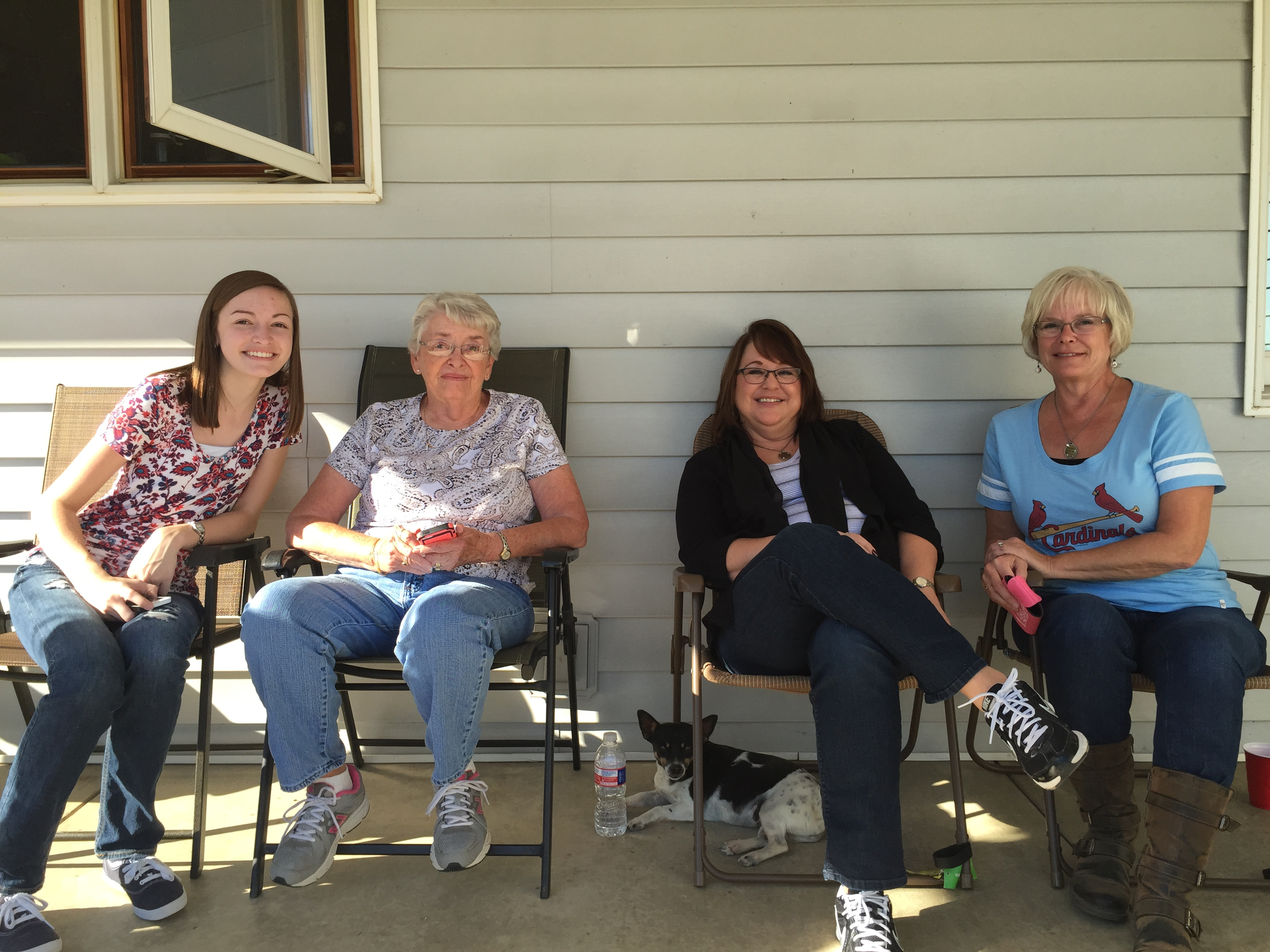 Grandma, daughters and granddaughter on the porch.