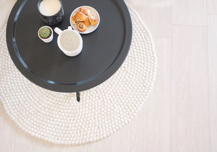 sukhi interior rug table   closeup hygge