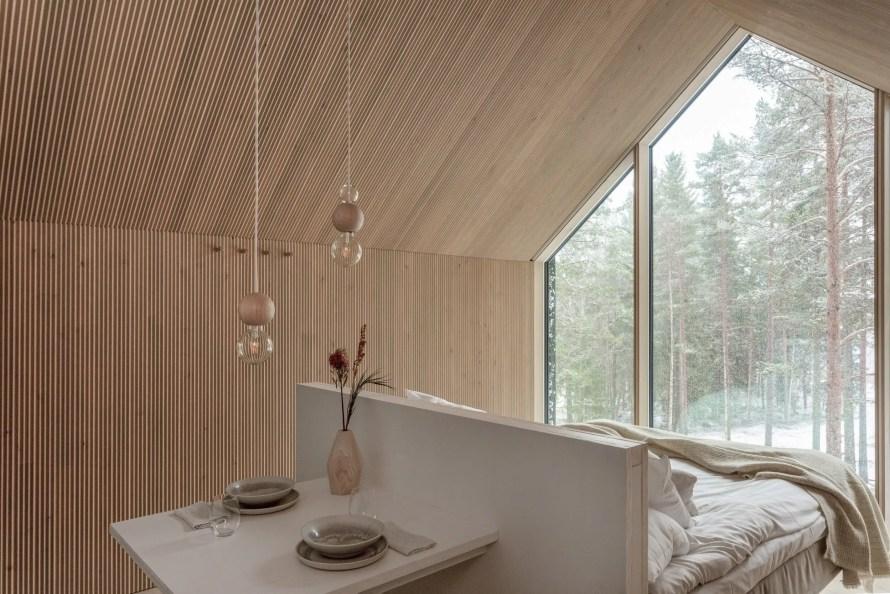 that scandinavian feeling cozy cabin finland interior windows bed