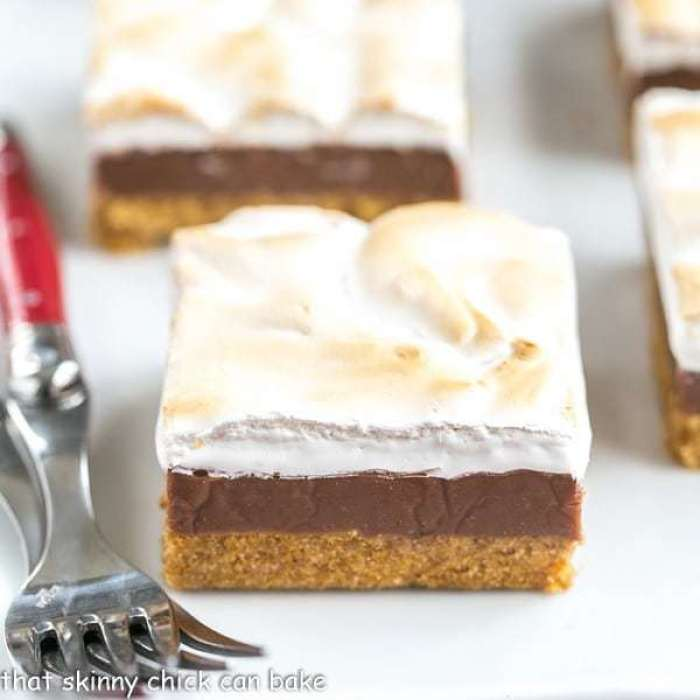 S'mores Fudge Bars on a white platter with 2 red handled forks