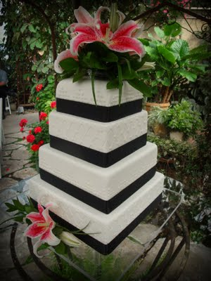 black and pink wedding cake stargazer lilies
