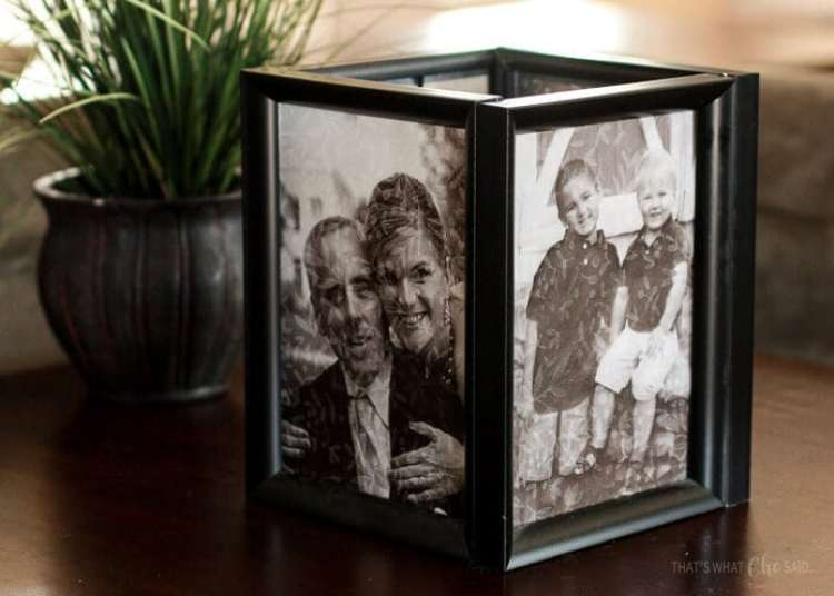 A photo luminary on the end table in a living room