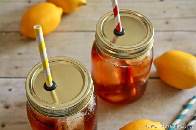 DIY Mason Jar Straw Lids. 2 jars with straw lids and lemons in the background.