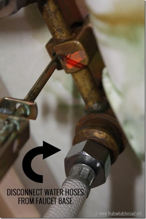 Disconnect water hoses from faucet base
