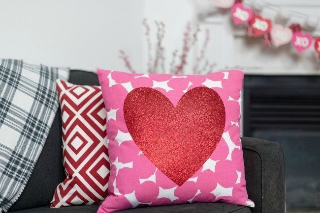 Pink and white pillow with glitter heart