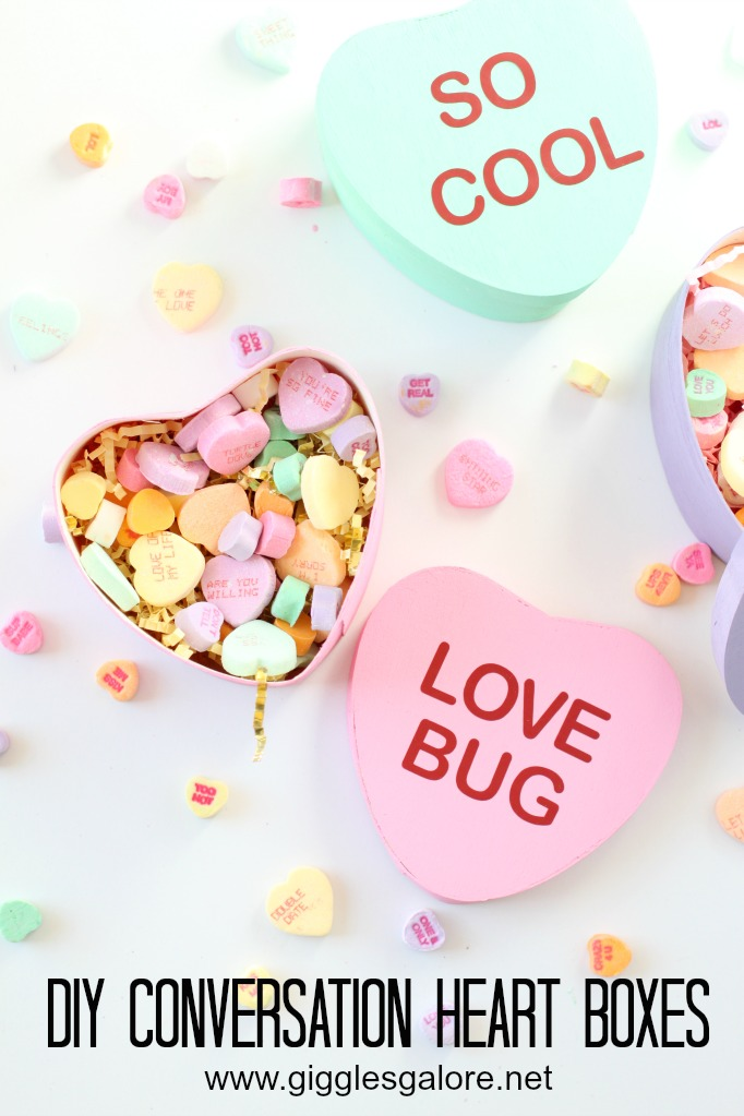 Paper mache heart boxes painted to look like conversation hearts