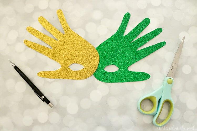 Handprint Mardi Gras Masks - Carefully cut out spots for the eye holes.