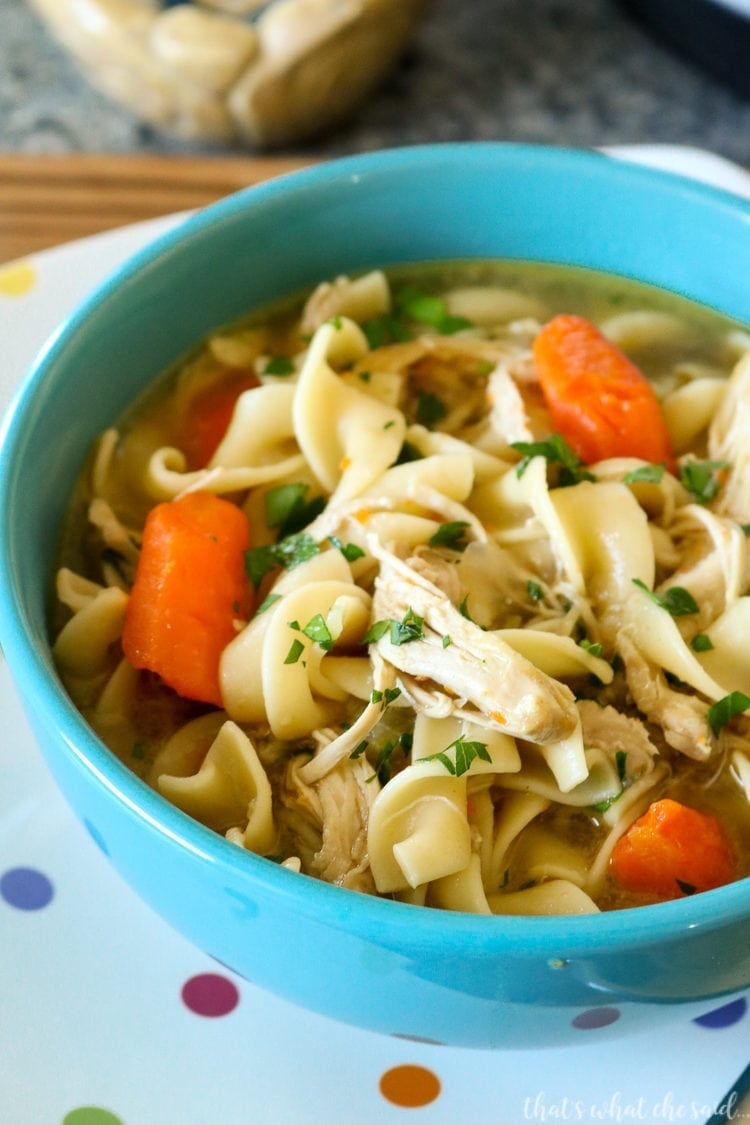Instant Pot Chicken Noodle Soup in a blue bowl on a polka dot plate