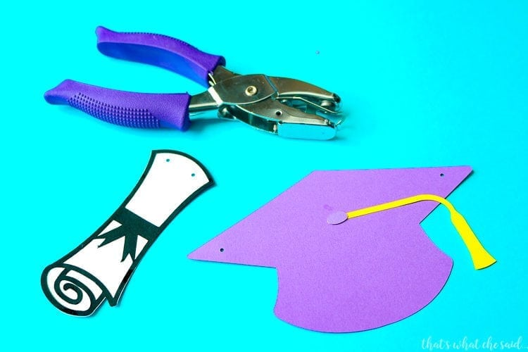 Paper Diplomas & Paper Graduation Hats punch with a Eighth inch hole punch.