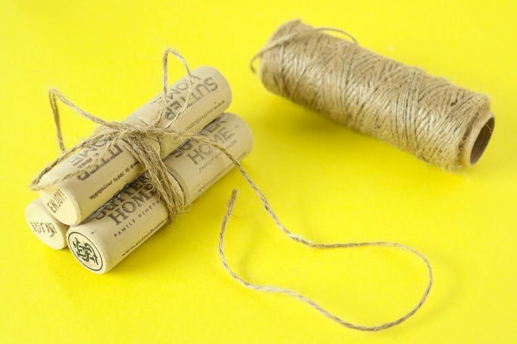 6 corks glued together in pairs and then tied with twine