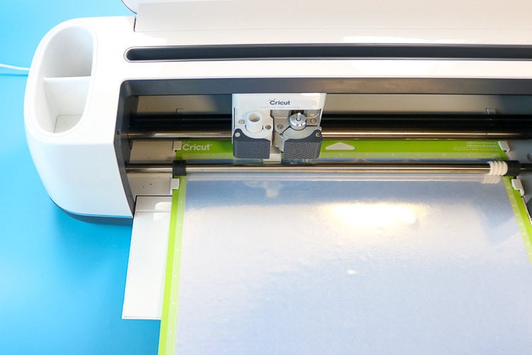 Cricut Maker with Foil Iron on loaded on a green mat