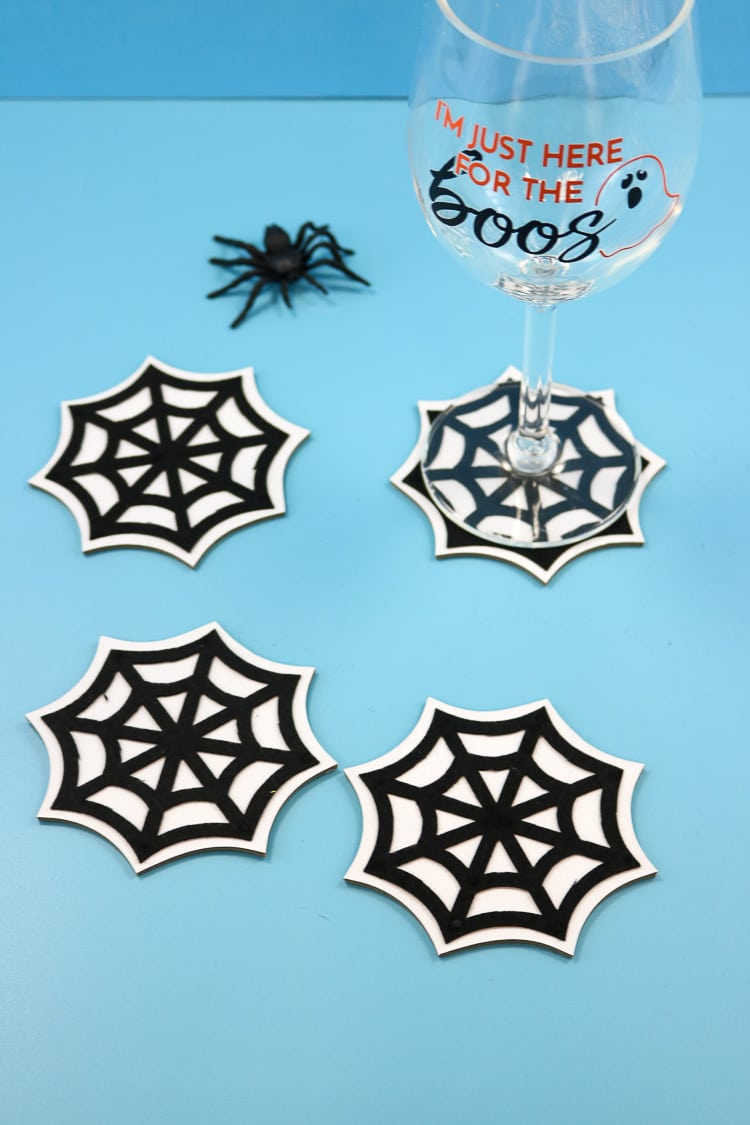 Spider web coasters with wine glass