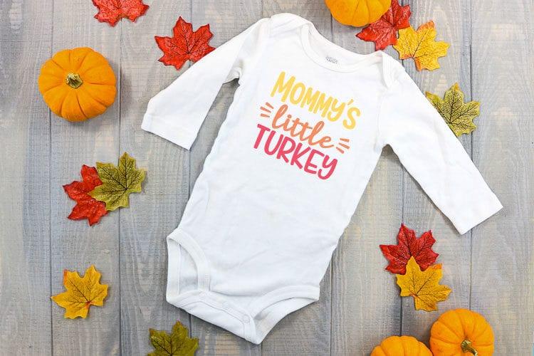 White baby bodysuit with Mommy's Little Turkey in Iron on vinyl