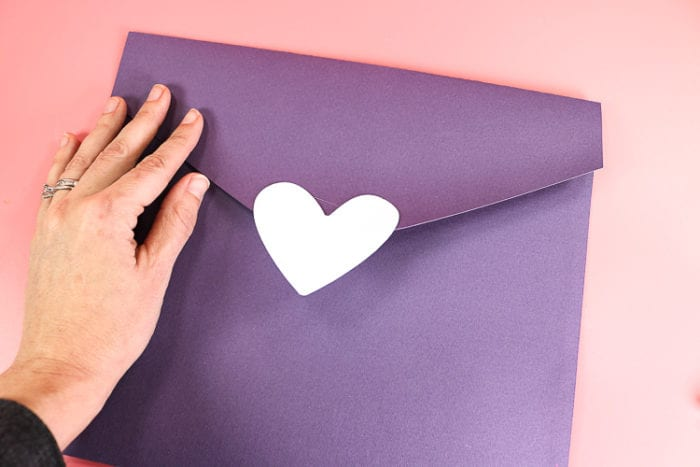 Fasten Heart and velcro to envelope flap