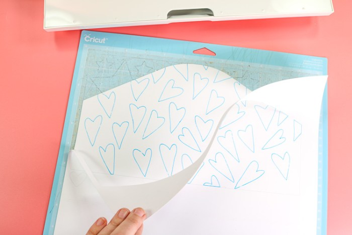 Image of Cardstock on Blue mat that has been scored, written on and now cut with the Cricut Maker