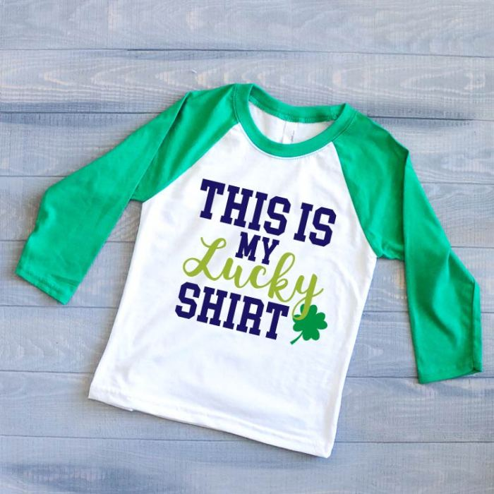 "Kid's Green & White Raglan with the St. Patrick's day SVG ""This is my Lucky Shirt"""
