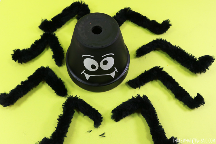 Clay pot with giant fuzzy spider legs