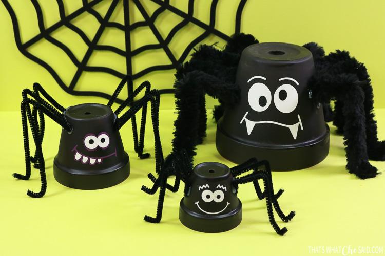 Three clay pots turned into spider halloween decor