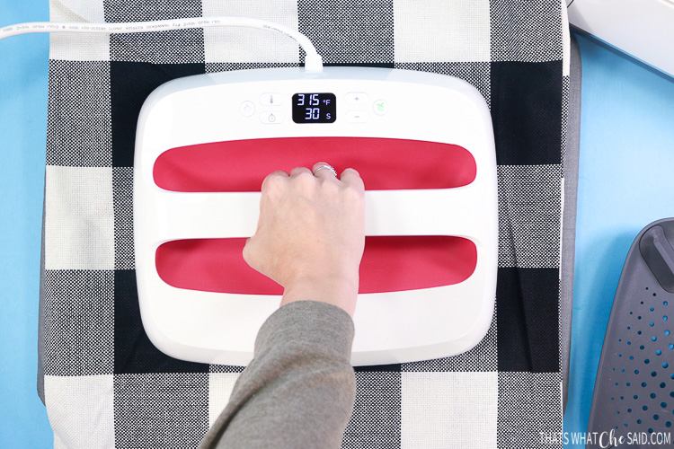 Showing the Large EasyPress pressing iron on onto pillow covers