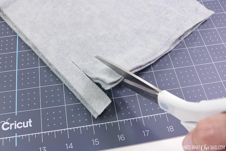"""Scissors cutting 3/4"""" fringe in fleece"""