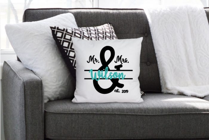 Grey couch with blanket and throw pillows and one has the Mr & Mrs in iron on for a personalized pillow!