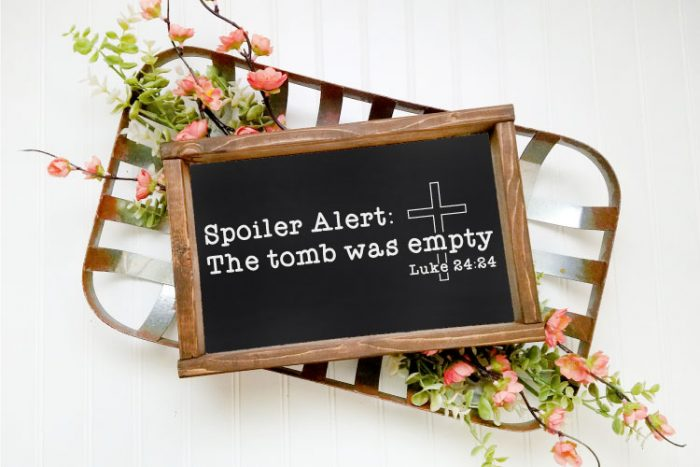 Wire Vintage Basket with some faux flowers with a black chalkboard sign with wooden frame. Religious SVG design is in white paint