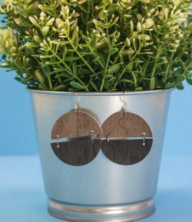 Semi Cirlce Earrings hanging on a faux plant pot