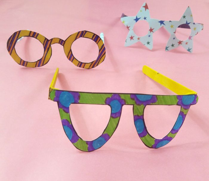 Fake glasses made from colored paper and popsicle sticks or straws.