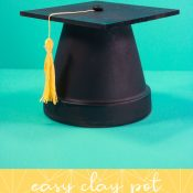Pin. Vertical of finished clay pot grad cap with words at the bottom