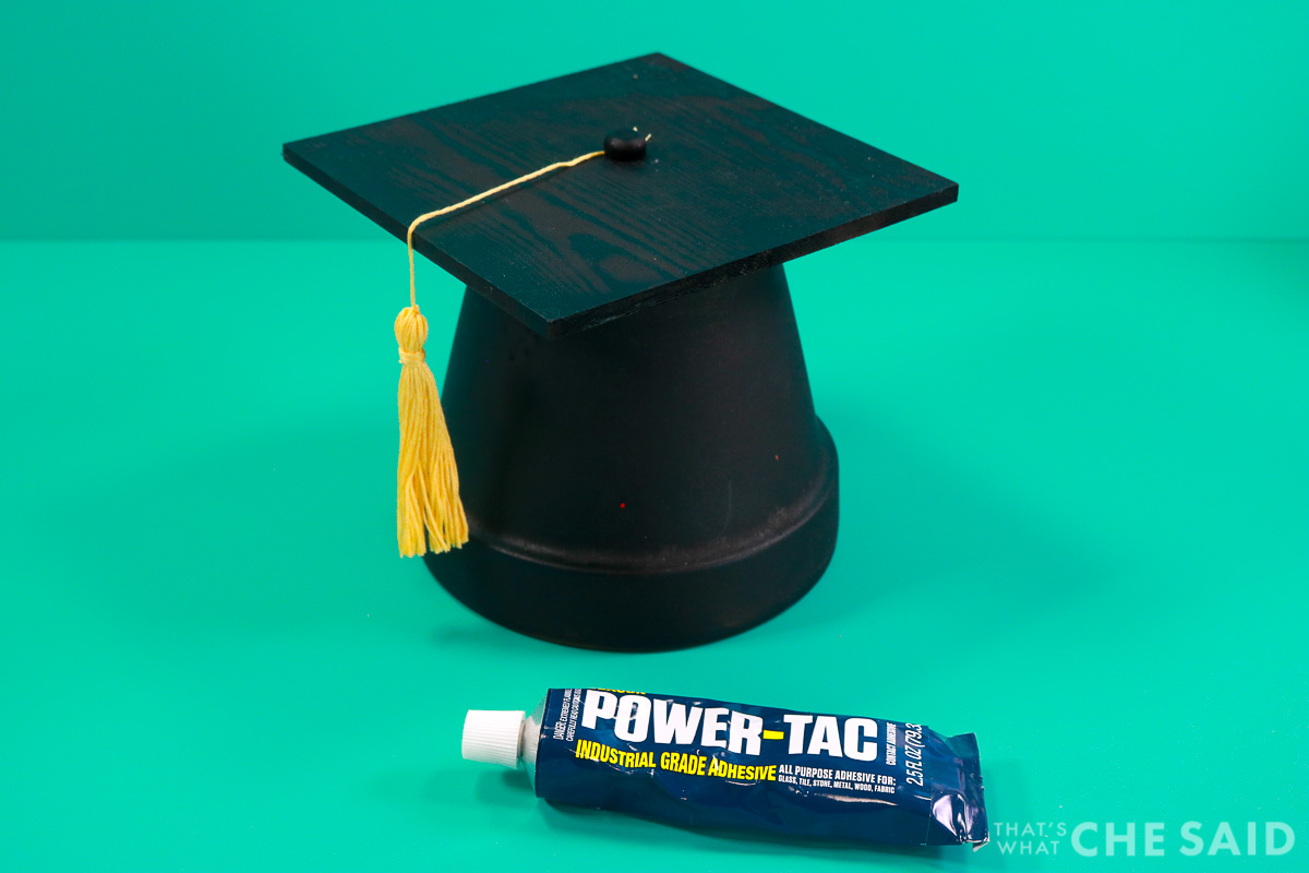 Complteted grad hat with glue bottle