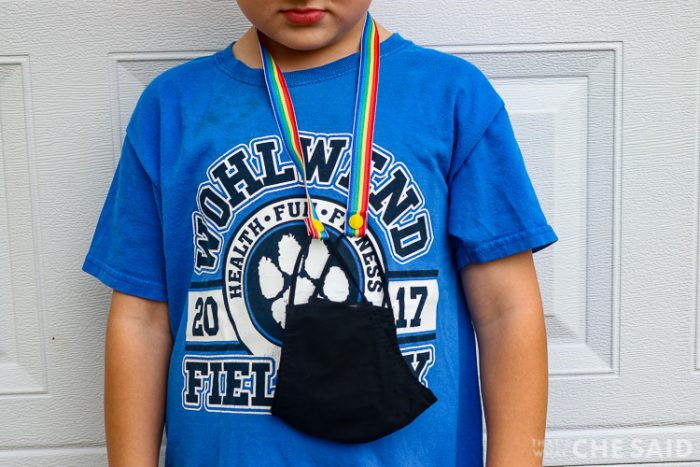 mask with mask lanyard hanging around a child's neck and body