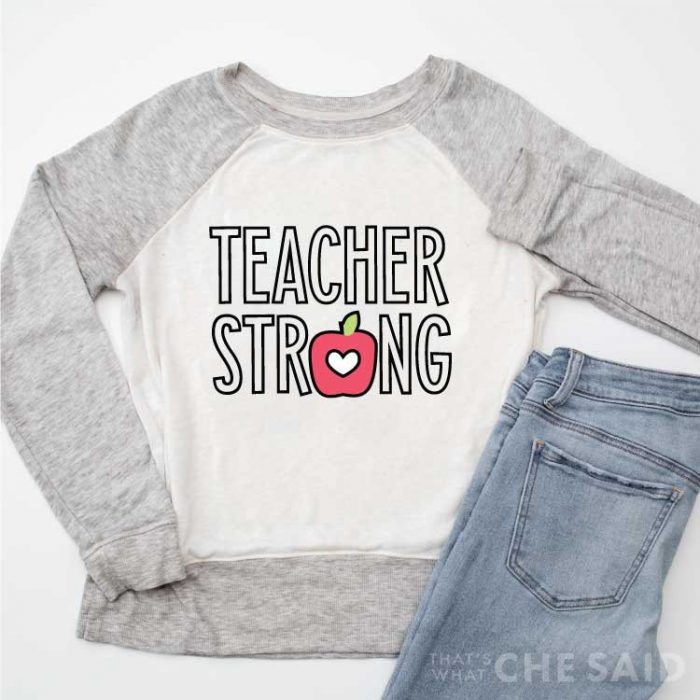 """Raglan sweatshirt with grey sleeves and white body with """"Teacher Strong"""" Design in Iron-on part of 14 free teacher svgs blog hop"""
