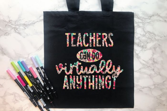 """Black Tote Bag with some Tombow Markers and """"Teachers Can Do Virtually Anything"""" in patterned floral leopard iron on in horizontal format"""