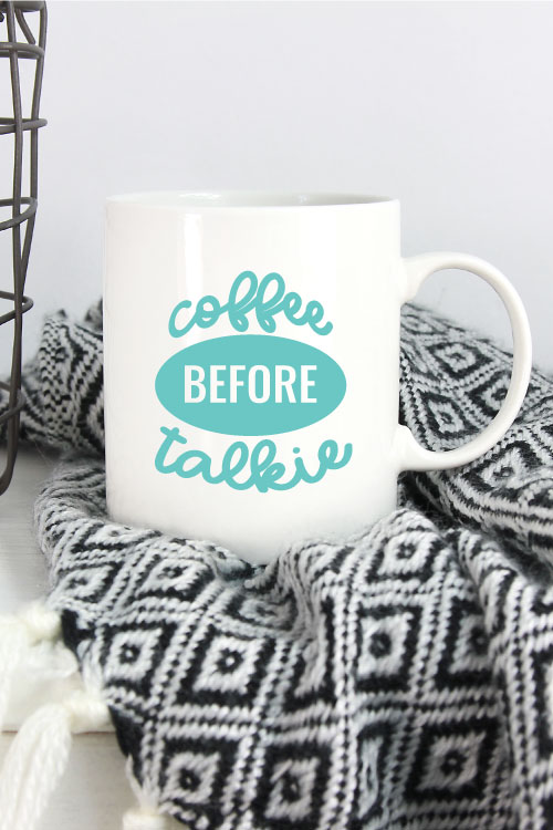 Black and White Blanket with White Mug and Coffee Before Talkie applied in aqua adhesive vinyl - Vertical Orientation