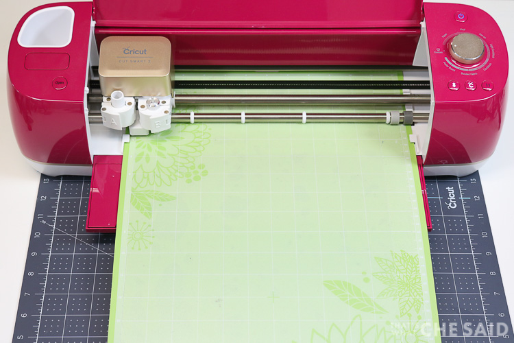 Cricut Explore Air 2 cutting a plastic cutting mat from dollar store to be used at a tracing mat