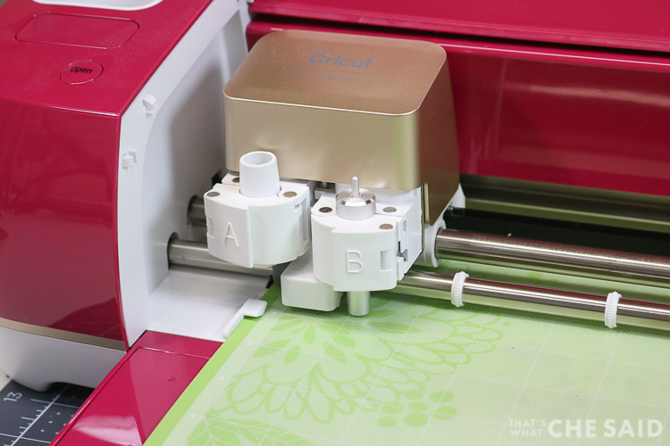 Close up of Cricut Explore Carriage cutting the letters into the tracing mat