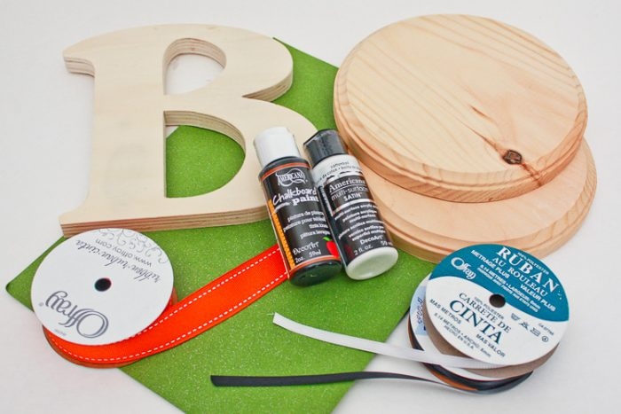 Supplies for Boo Door Hanging: 2 wooden circles, wooden B, Paint, Paint brush, Ribbon, Cardstock, Red Pen