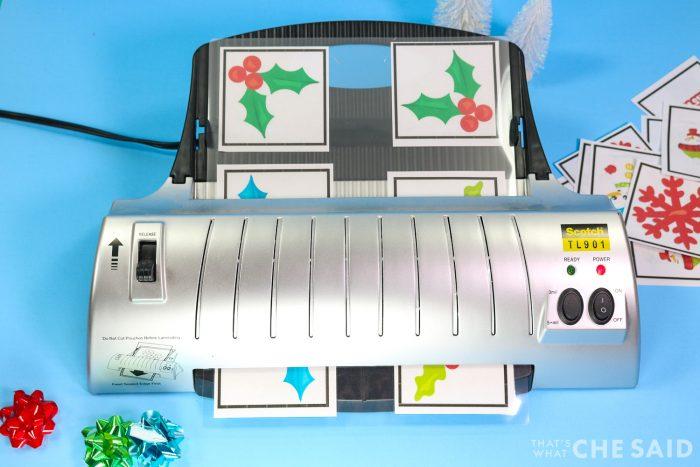 Running the sheet through the laminator