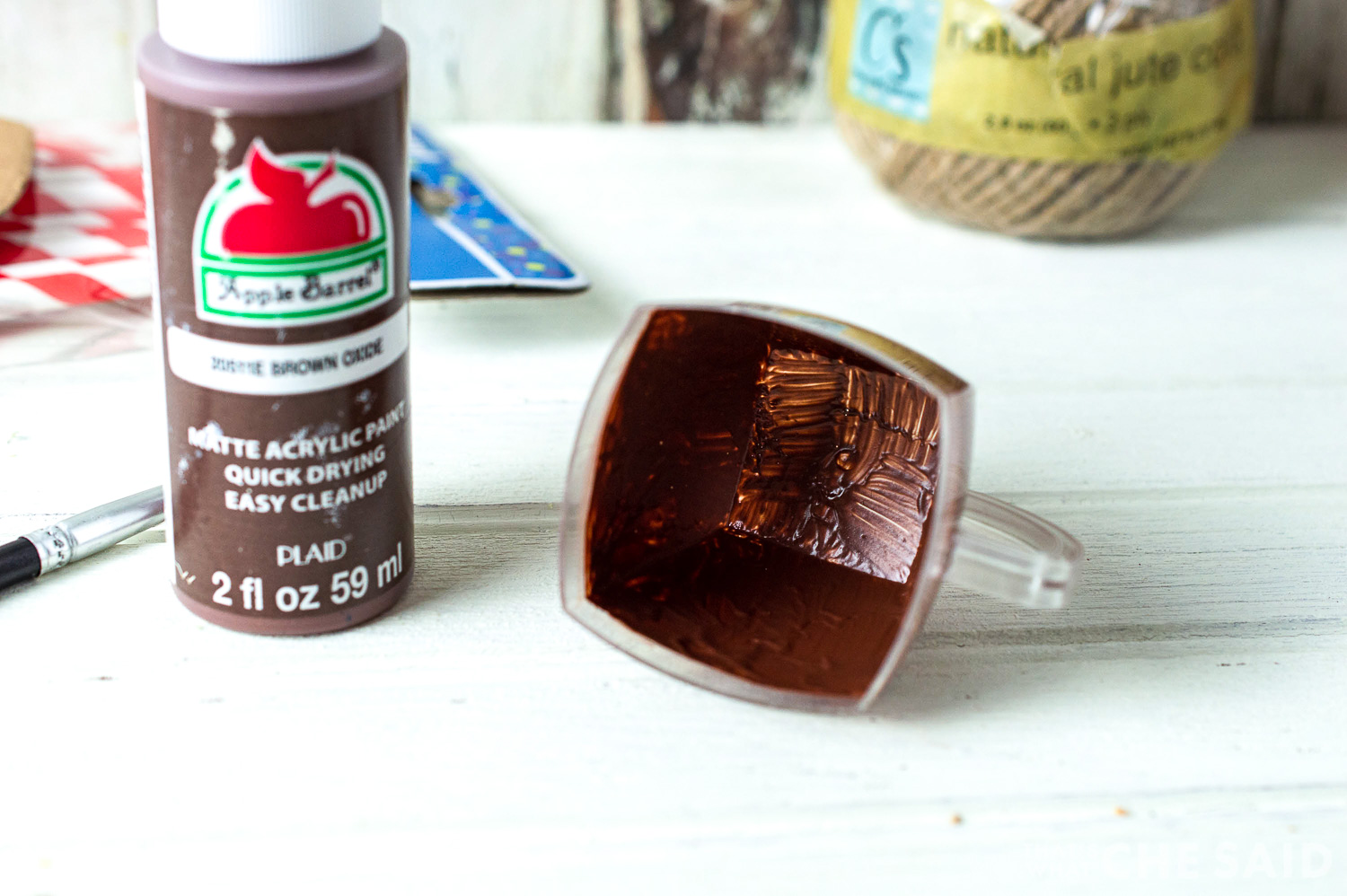 small clear mini cup painted brown inside with acrylic paint