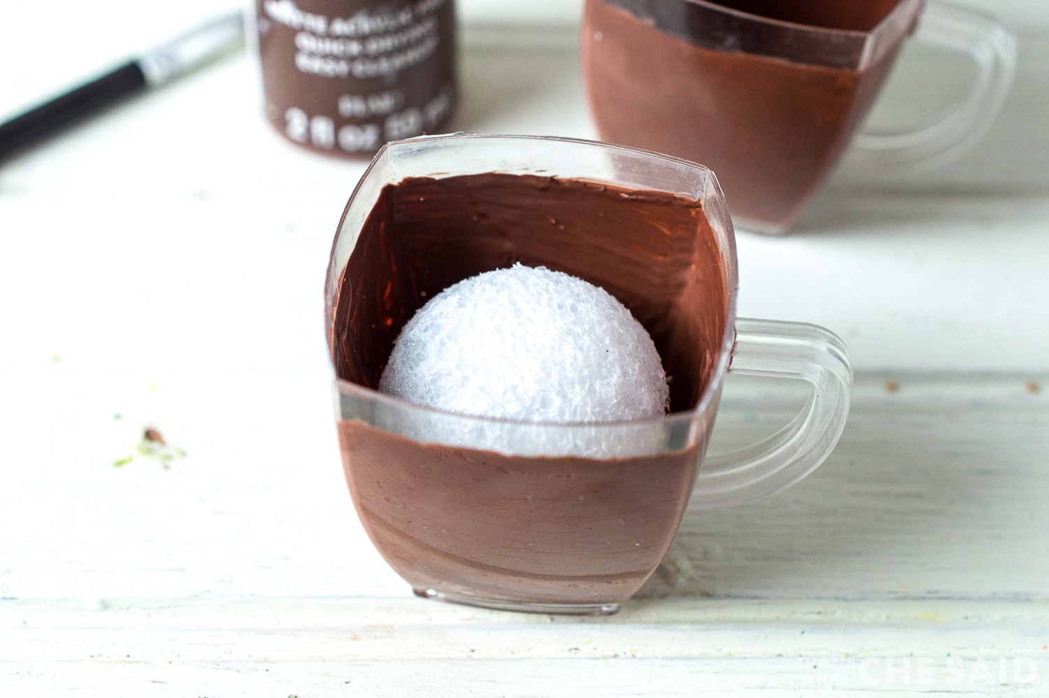 Add styrofoam ball inside cup to take up space