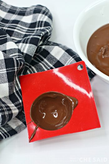 Showing the silicone mold that has been covered in chocolate