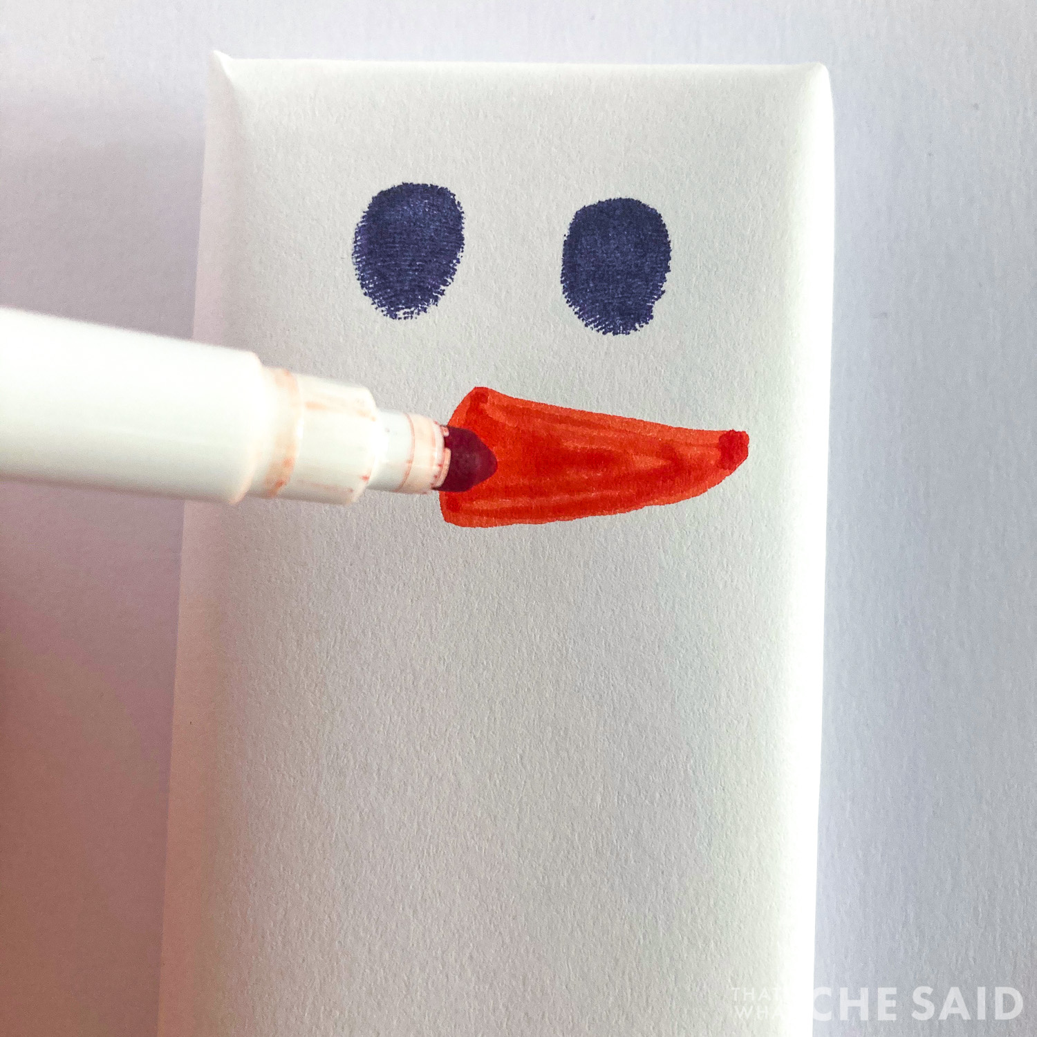 drawing the carrot nose with orange marker