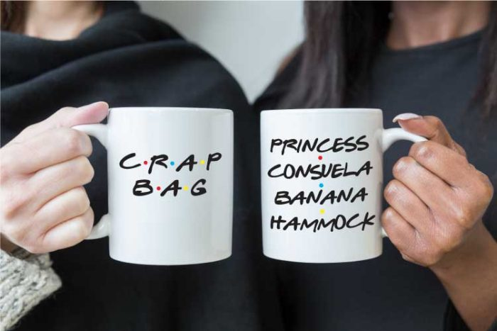 Two people holding coffee mugs that read FRIENDS tv show quotes