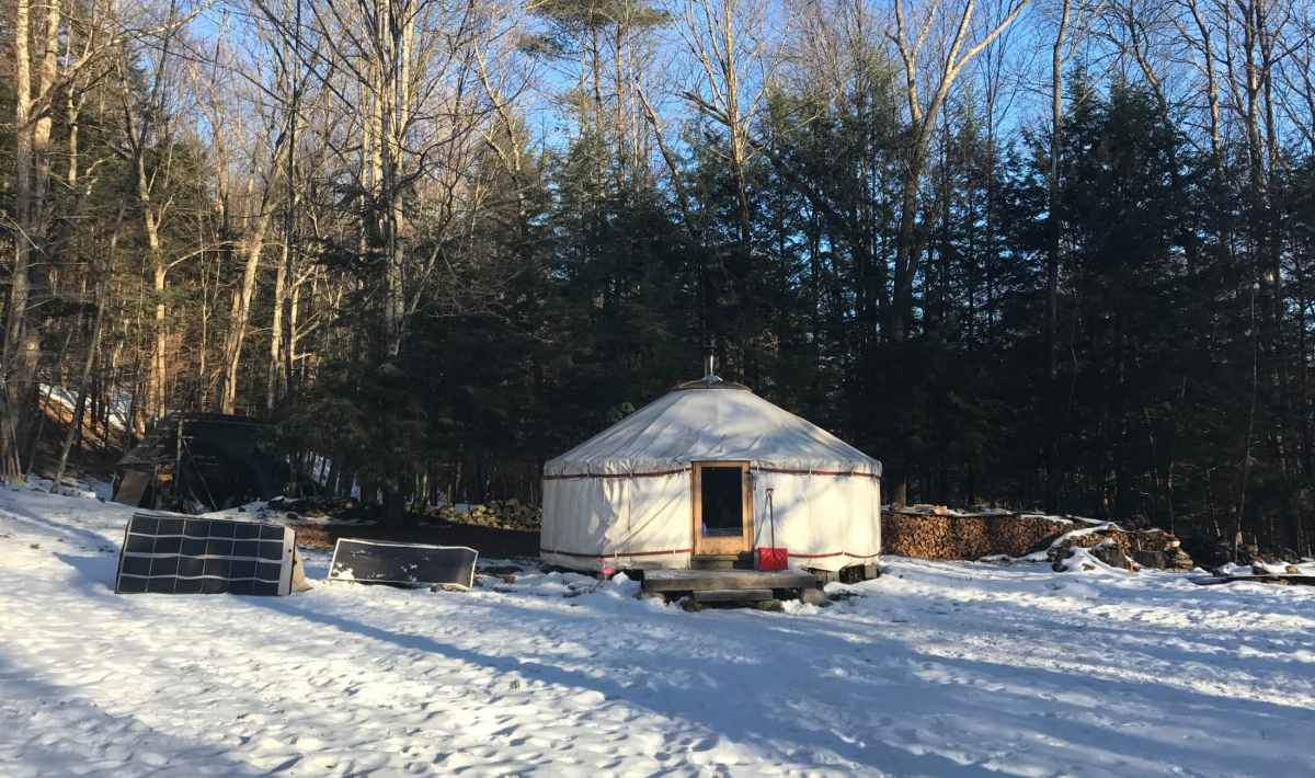 Yurt with solar panels in the snow