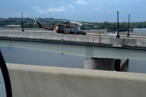 A Maryland State Police helicopter lands on bridge near D.C. Navy Yard. WJLA photo by Jay Korff