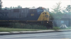 CSX coat trains travel from the main line at Bowie south to the Morgantown power plant at the Potomac River.  This engine approaches the bumpy crossing at Leonardtown Road in Waldorf.  THE CHESAPEAKE TODAY PHOTO