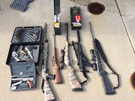 Anne Arundel Police seized five handguns and five rifles in raid on drug dealer in Glen Burnie.